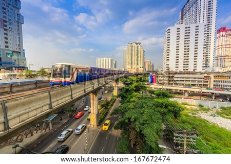 BANGKOK - DECEMBER 5: BTS Skytrain on elevated rails in Jatujak Station on December 5, 2013 in Bangkok, Thailand. It's the first electric train system in Thailand. - stock photo