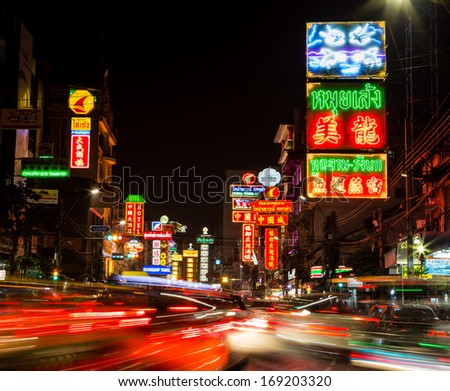 BANGKOK - DECEMBER 31: Busy Yaowarat Road in the evening on DEC 31, 2013 in Bangkok. Yaowarat Road is a main street in Bangkok's Chinatown, it was opened in 1891 in the reign of King Rama V.  - stock photo