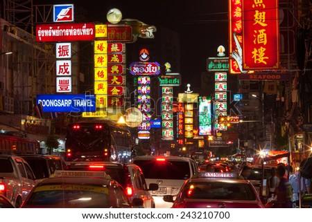 BANGKOK - DECEMBER 31: Busy Yaowarat Road in the night on December 31, 2014 in Bangkok. Yaowarat Road is a main street in Bangkok's Chinatown. - stock photo
