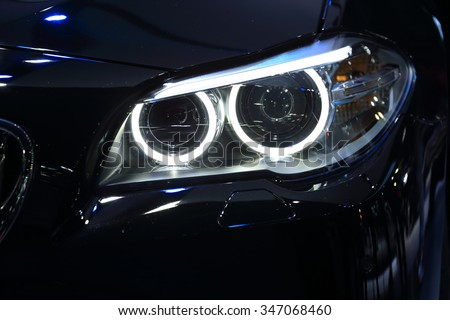 BANGKOK - DECEMBER 1 : Closed up BMW's head light displayed at Thailand International Motor Expo2015 (MOTOR EXPO 2015) exhibition of vehicles for sale on December 1, 2015 in Bangkok, Thailand. - stock photo