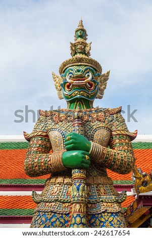BANGKOK - DECEMBER 16: Demon Guardian at the temple Wat Phra Kaew on December 16, 2014 in Bangkok. Wat Phra Kaew or Wat of the Emerald Buddha is regarded as the most sacred Buddhist temple in Thailand - stock photo