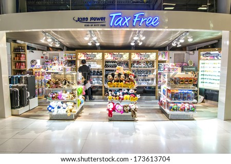 BANGKOK-DECEMBER 25:Duty-free shops in arrival terminal in Suvarnabhumi Airport on December 25, 2013 in Bangkok ,Thailand.This airport is handling about 45 million passengers annually. - stock photo