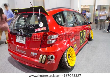 BANGKOK - December 9: Honda Jazz racing car on display at The 30th Thailand International Motor Expo at Impact Muang Thong Thani on December 9, 2013 in Bangkok, Thailand
