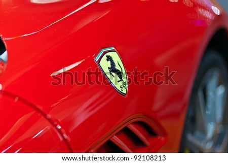 BANGKOK - DECEMBER 2: Logo of ferrari on the sport car at Motor Expo, Impact on December 2, 2010 in Bangkok, Thailand. - stock photo