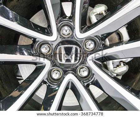 Bangkok - December 28 : logo of Honda on wheel - in display at Thailand international motor expo 2014 on December 28, 2014 in Bangkok Thailand  - stock photo
