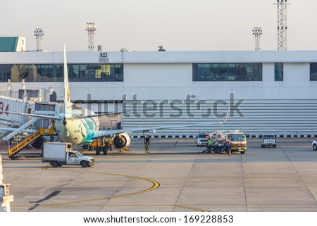 BANGKOK - DECEMBER 18: Nok Air flights  for servicing at Don Mueang International Airport on Dec 18, 13 in Bangkok. It is considered to be one of the worlds oldest international airports.