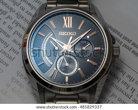 BANGKOK - DECEMBER 3 : Seiko automatic watch, black dial, subdial day, date and power reserve indicator on English paper, selective focus on its brand name, on December 3, 2015, in Bangkok, Thailand