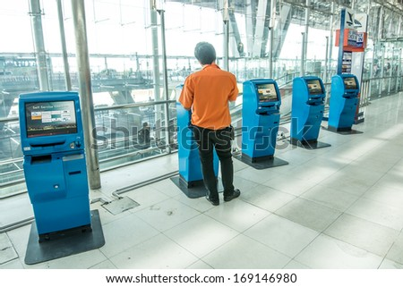 BANGKOK -DECEMBER 24:Self service check-in machine in Suvarnabhumi Airport on December 24, 2013 in Bangkok ,Thailand.This airport is handling about 45 million passengers annually. - stock photo