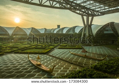BANGKOK -DECEMBER 22: Suvarnabhumi Airport at morning on December 22, 2013 in Bangkok, Thailand.This airport is the world's third largest single building airport terminal designed by Helmut Jahn. - stock photo