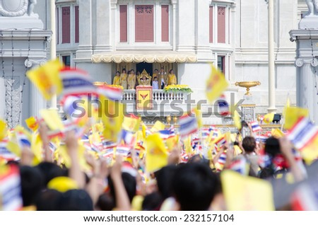BANGKOK - DECEMBER 5: Thai people sit outside to celebrate for the 85th birthday of HM King Bhumibol Adulyadej on December 5, 2012 in Bangkok, Thailand. - stock photo