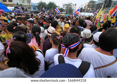BANGKOK - DECEMBER 9 : Thai protesters join an aiti-government rally to the Government House  on Dec 9, 2013 in Bangkok, Thailand.