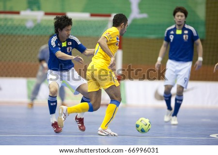 BANGKOK - DECEMBER 11 : Thailand vs Japan, Bangkok Futsal Super Match 2010,Suphawut Tompa (R) and Mitsuyoshi Matsumiya (L) on DECEMBER 11 -12, 2010 in Bangkok Thailand. - stock photo
