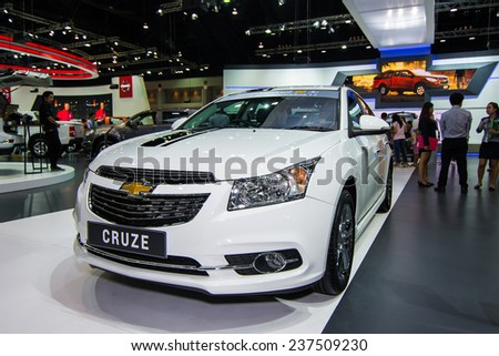 BANGKOK - DECEMBER 4 : Unidentified model with Chevrolet Cruze on display at The 31st Bangkok International Motor Expo on DECEMBER 4, 2014 in Bangkok, Thailand.