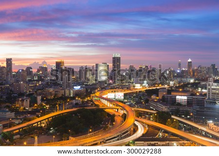Bangkok elevated road junction and interchange overpass during twilight  - stock photo