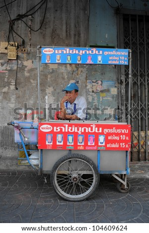 BANGKOK - FEB 3: An unidentified iced drink street vendor waits for customers in Bangkok's Chinatown Feb 3, 2011 in Bangkok, Thailand. There are more than 16,000 registered street vendors in Bangkok. - stock photo