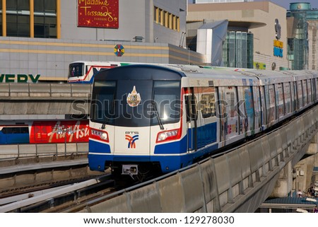 BANGKOK - FEB 27: BTS Skytrain passes by on elevated rails above Sukhumvit Road on February 27, 2012 in Bangkok, Thailand. Each train of the mass transport rail network can carry over 1,000 passengers - stock photo