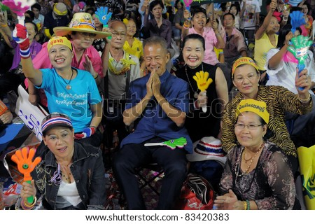 BANGKOK - FEB 8: Key yellow-shirt leader Major General Chamlong Srimuang (c) amongst supports during a rally outside Government House Feb 8, 2011 in Bangkok, Thailand. - stock photo