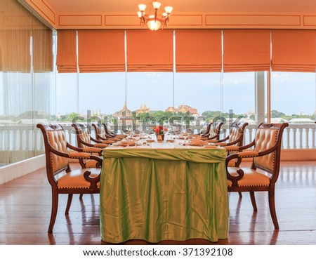 "BANGKOK - FEB,3 :The classic table and nice chairs for dinner set of royal Thai Navy interior indoor is decorated for visitor everyday where named "" OFFICER CLUB RESTAURANT "" THAILAND FEB,3  2016"