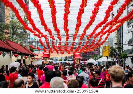 BANGKOK - FEBRUARY 19 : People walking  at Main street of Chinatown in Chinese New Year celebrations on February 19, 2015 at Yaowaraj road, Bangkok, Thailand - stock photo