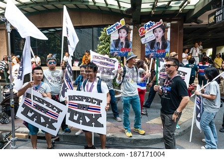 BANGKOK - FEBRUARY 2: Unidentified group of people holding protest sign for Thailand's protest against the government at central Bangkok on February 2, 2014 in Bangkok, Thailand - stock photo