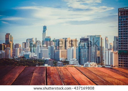Bangkok in the evening wooden floor , Panoramic and perspective view light blue background  building skyscraper commercial of future. Business concept of success industry tech architecture,pastel tone - stock photo