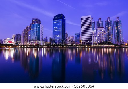 Bangkok in the night with building reflect on water