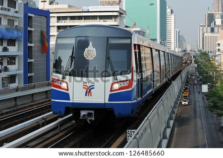 BANGKOK - JAN 25: A BTS Skytrain on elevated rails in Ratchathewi district on Jan 25, 2013 in Bangkok, Thailand. Each train of the mass transport rail network can carry over 1,000 passengers.