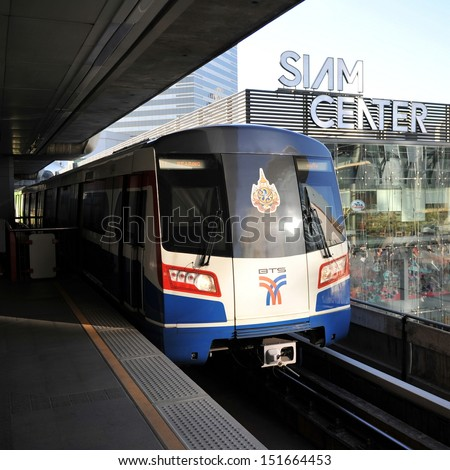 BANGKOK - JAN 14: A BTS Skytrain pulls into Siam station in the city centre on Jan 14, 2013 in Bangkok, Thailand. Each train of the mass transport rail network can carry over 1,000 passengers.
