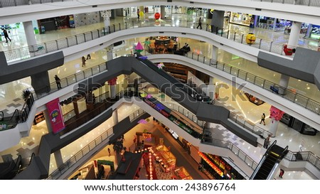 BANGKOK - JAN 22: A general view of the interior of the Gateway Ekamai shopping mall on Jan 22, 2013 in Bangkok, Thailand. The Japanese themed mall has features 400 stores over 8 floors. - stock photo