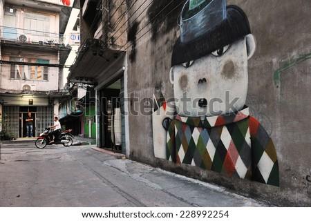 BANGKOK - JAN 14: A graffiti piece by an unidentified artist is seen on an inner city centre street on Jan 14, 2013 in Bangkok, Thailand. The Thai capital has a vibrant street art scene. - stock photo