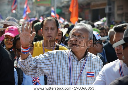 BANGKOK - JAN 6: Anti-government protest leader Suthep Thaugsuban greets supporters while leading a rally on Jan 6, 2014 in Bangkok, Thailand. Anti-government movement calls for political reform.