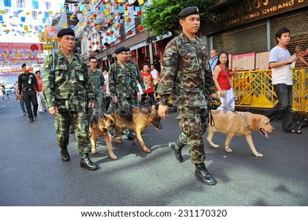 BANGKOK - JAN 23: Army patrol a Chinatown street before a visit by Thai royalty during celebrations of the Chinese New Year on Jan 23, 2012 in Bangkok, Thailand.   - stock photo