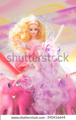 BANGKOK - Jan 9, 2016 : Barbie on Unicorn surrounding with ponies from My Little Pony for display. Barbie is a fashion doll manufactured by the American toy-company Mattel and launched in March 1959. - stock photo