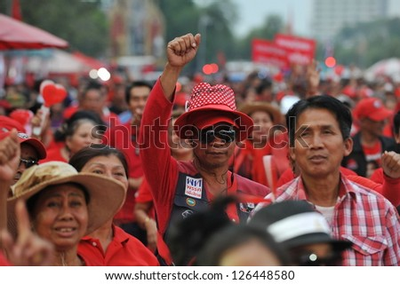 BANGKOK - JAN 29: Red-shirt demonstrators join a large rally on the Royal Plaza to protest against lese majeste law and legal restraints on freedom of speech on JaN 29, 2013 in Bangkok, Thailand.