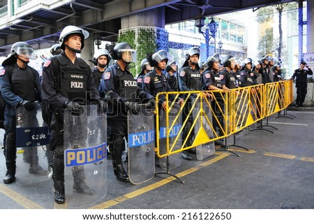 BANGKOK - JAN 9: Riot police block an entrance to Sukumvit Road during a 30,000 strong anti government Red Shirt protest in the city centre of the Thai capital on Jan 9, 2011 in Bangkok, Thailand.