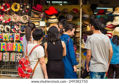 BANGKOK - JAN 25: Tourists and locals shop at Chatuchak Weekend Market January 25, 2015 in Bangkok, Thailand. Chatuchak is the world's largest outdoor street markets with 15,000 stalls. - stock photo