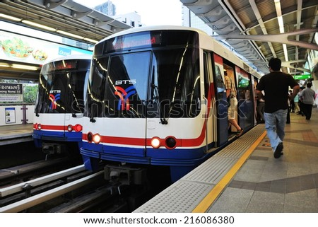 BANGKOK - JAN 13: Travellers board a BTS Skytrain at a city centre station on Jan 13, 2011 in Bangkok Thailand. The Thai capital's BTS rail public transport system serves 600,000 passengers daily.