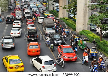 BANGKOK - JAN 23: View of a traffic jam on a city centre road on Jan 23, 2013 in Bangkok, Thailand. With the government's first car policy, gridlocked streets in the Thai capital have increased.