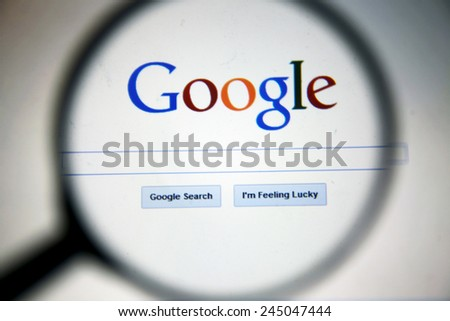 BANGKOK-JANUARY 17 2015: Magnifying Google.com Home Page. Google is an American multinational corporation specializing in Internet-related services and products.  - stock photo