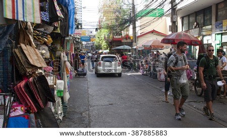 BANGKOK - JANUARY 17, 2016:Shopper and vendor in the crowded street on bazaar.