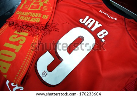 BANGKOK - JANUARY 8: The shirt and scarf of Jay Bothroyd footballer from England during opening the new player of Muangthong United at SCG Stadium on January 8, 2014 in Bangkok.  - stock photo