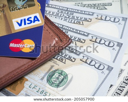 BANGKOK - JUL 14, 2014 : Photo of VISA and Mastercard credit card. VISA and Mastercard is an American multinational financial services corporation - stock photo