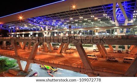 BANGKOK - JUL 20: Suvarnabhumi Airport at night on July 20, 2012 in Bangkok ,Thailand. This airport is the world's third largest single building airport terminal designed by Helmut Jahn. - stock photo