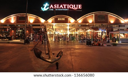 BANGKOK-JUL 07: Unidentified people visit Asiatique The Riverfront at night on July 07, 2012 in Bangkok, Thailand. Three are more than 500 outdoor shopping stores in Asiatique The Riverfront.