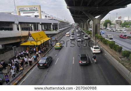 BANGKOK -July 01 : Bus station in front of Don Mueang international airport, Bangkok, Thailand on 01 July 2014. From here you can catch a bus into the downtown with cheaper price. - stock photo