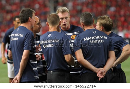 BANGKOK - JULY 13:David Moyes of Man Utd. talk with staff coach during Singha 80th Anniversary Cup Manchester United vs Singha All Star at Rajamangala Stadium on July 13,2013 in Bangkok, Thailand.