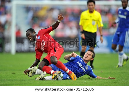 BANGKOK - JULY 24 : F.Lampard (R) in action during Coke Super Cup :Chelsea Asia Tour 2011 Thailand. TPL All Star between Chelsea at Rajamangla Stadium ,July 24, 2011 in Bangkok, Thailand. - stock photo