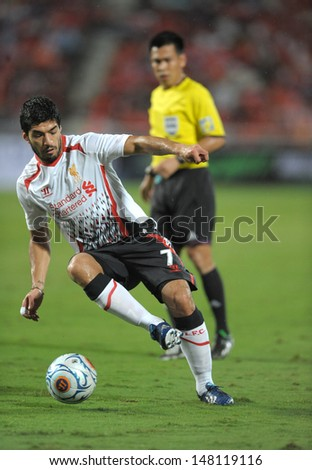 BANGKOK, JULY 28: Luis Suarez of Liverpool in action during Liverpool FC Tour 2013 Thailand between Thailand (r) and Liverpool (w) at the Rajamangala Stadium on July 28, 2013 in Bangkok, Thailand.
