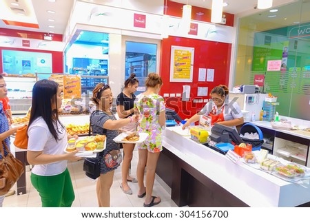 BANGKOK - JULY 23: People shop at Tops Suppermarket on July 23, unidentified people walking in bakery in supermarket to buy everything they want. - stock photo