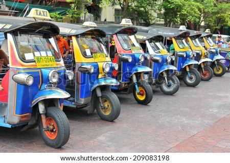 BANGKOK - JULY 27: Thai Tuk Tuk taxi on Khaosarn road on July 27, 2014 in Bangkok, Thailand.  - stock photo
